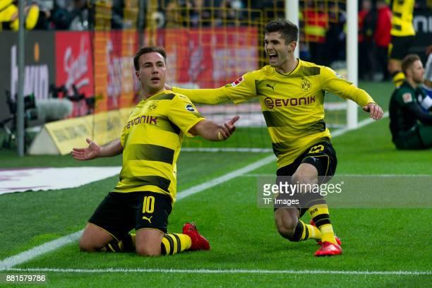 Mario Goetze of Dortmund celebrates after scoring his team`s third goal with team mate Christian Pulisic of Dortmund during the Bundesliga match...