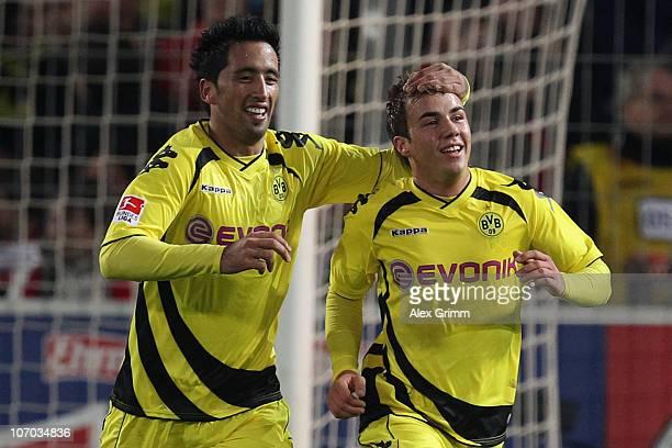 Mario Goetze of Dortmund celebrates his team's second goal with team mate Lucas Barrios during the Bundesliga match between SC Freiburg and Borussia...