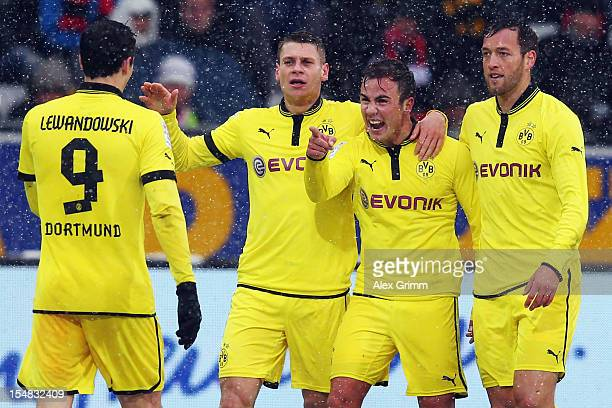 Mario Goetze of Dortmund celebrates his team's second goal with team mates Robert Lewandowski, Lukasz Piszczek and Julian Schieber during the...
