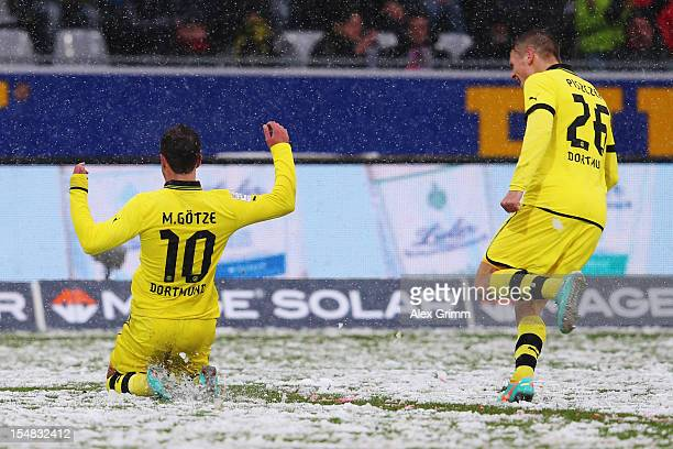 Mario Goetze of Dortmund celebrates his team's second goal with team mate Lukasz Piszczek during the Bundesliga match between SC Freiburg and...