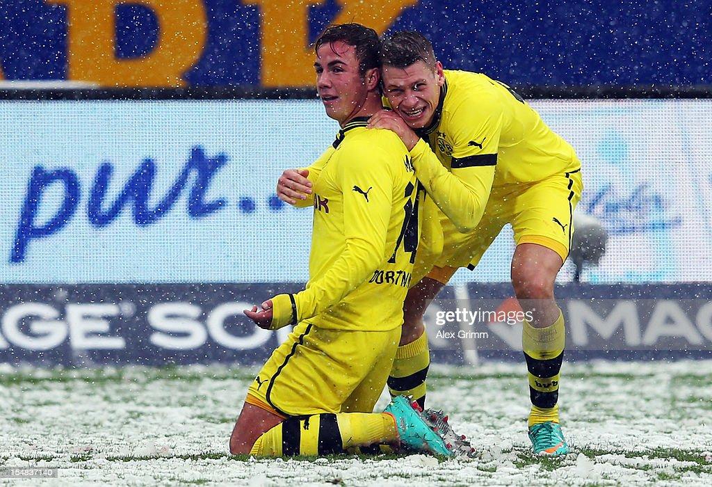 Mario Goetze (L) of Dortmund celebrates his team's second goal with team mate Lukasz Piszczek during the Bundesliga match between SC Freiburg and Borussia Dortmund at MAGE SOLAR Stadium on October 27, 2012 in Freiburg im Breisgau, Germany.