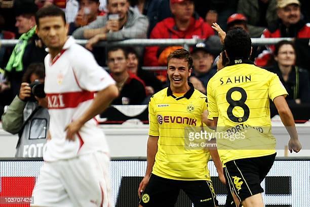 Mario Goetze of Dortmund celebrates his team's third goal with team mate Nuri Sahin as Khalid Boulahrouz of Stuttgart reacts during the Bundesliga...