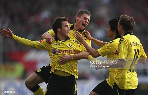 Mario Goetze of Dortmund celebrates the first goal with Lukasz Piszczek of Dortmund Shinji Kagawa and Kevin Grosskreutz during the Bundesliga match...