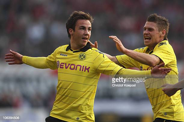 Mario Goetze of Dortmund celebrates the first with Lukasz Piszczek of Dortmund during the Bundesliga match between FSV Mainz 05 and Borussia Dortmund...