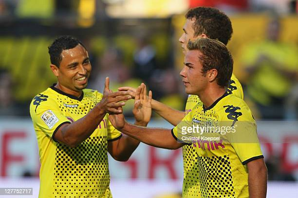 Mario Goetze of Dortmund celebrates the third goal with Antonio da Silva and Ivan Perisic during the Bundesliga match between Borussia Dortmund and...
