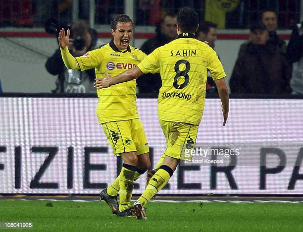 Mario Goetze of Dortmund celebrates the third goal with Nuri Sahin of Dortmund during the Bundesliga match between Bayer Leverkusen and Borussia...