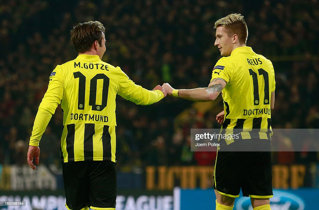 Mario Goetze (L) of Dortmund celebrates with his team mate Marco Reus after scoring his team's second goal during the UEFA Champions League round of 16 leg match between Borussia Dortmund and Shakhtar Donetsk at Signal Iduna Park on March 5, 2013 in Dortmund, Germany.