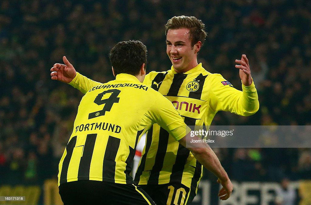 Mario Goetze (R) of Dortmund celebrates with his team mate Robert Lewandowski after scoring his team's second goal during the UEFA Champions League round of 16 leg match between Borussia Dortmund and Shakhtar Donetsk at Signal Iduna Park on March 5, 2013 in Dortmund, Germany.
