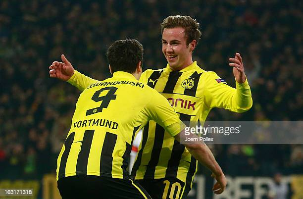 Mario Goetze of Dortmund celebrates with his team mate Robert Lewandowski after scoring his team's second goal during the UEFA Champions League round...