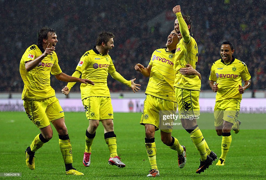 Mario Goetze of Dortmund celebrates with Kevin Grosskreutz, Nuri Sahin and other team mates after scoring his teams third goal during the Bundesliga match between Bayer Leverkusen and Borussia Dortmund at BayArena on January 14, 2011 in Leverkusen, Germany.