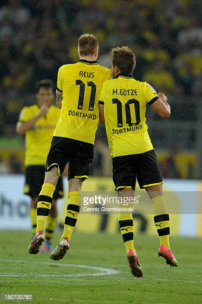Mario Goetze of Dortmund celebrates with teammate Marco Reus after scoring his team's second goal during the Bundesliga match between Borussia...
