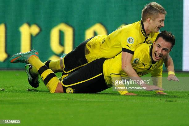 Mario Goetze of Dortmund celebrates with teammate Marco Reus after scoring his team's third goal during the DFB Cup match between Borussia Dortmund...