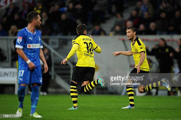 Mario Goetze of Dortmund celebrates with teammates after scoring a goal during the Bundesliga match between TSG 1899 Hoffenheim and Borussia Dortmund...