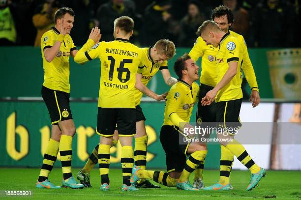 Mario Goetze of Dortmund celebrates with teammates after scoring his team's third goal during the DFB Cup match between Borussia Dortmund and...