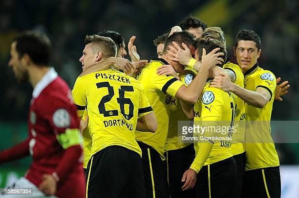 Mario Goetze of Dortmund celebrates with teammates after scoring the first goal during the DFB Cup match between Borussia Dortmund and Hannover 96 at...