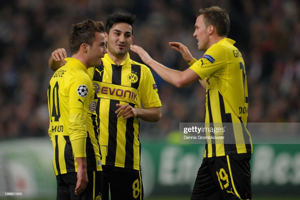 Mario Goetze of Dortmund celebrates with teammates Ilkay Guendogan and Kevin Grosskreutz after scoring his team's second goal during the UEFA Champions League Group D match between Ajax Amsterdam and Borussia Dortmund at Amsterdam Arena on November 21, 2012 in Amsterdam, Netherlands.