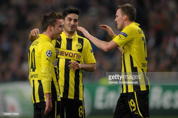 Mario Goetze of Dortmund celebrates with teammates Ilkay Guendogan and Kevin Grosskreutz after scoring his team's second goal during the UEFA...