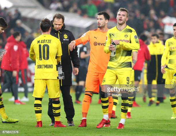 Mario Goetze of Dortmund Dr Markus Braun Goalkeeper Roman Buerki of Dortmund and Andrej Yarmolenko of Dortmund look on during the Bundesliga match...