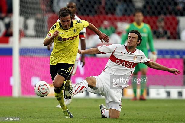 Mario Goetze of Dortmund eludes Christian Gentner of Stuttgart during the Bundesliga match between VfB Stuttgart and Borussia Dortmund at the...