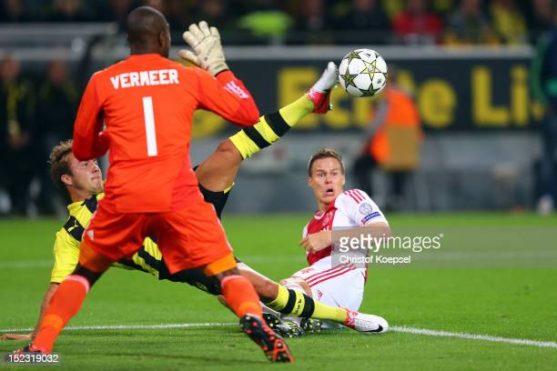 Mario Goetze of Dortmund failes against Kenneth Vermeer of Amsterdam and Niklas Moisander of Amsterdam during the UEFA Champions League group D match...