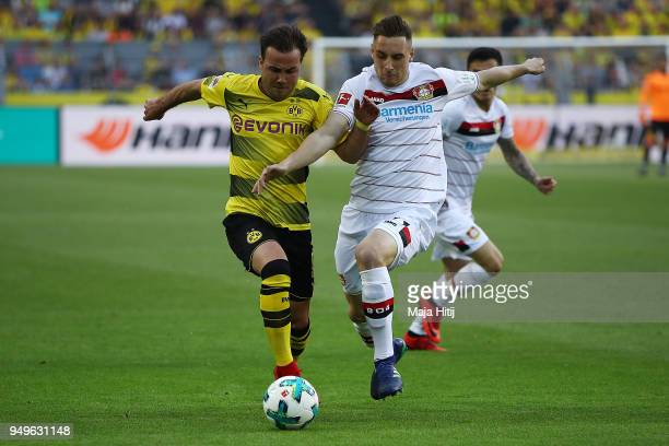 Mario Goetze of Dortmund fights for the ball with Dominik Kohr of Bayer Leverkusen during the Bundesliga match between Borussia Dortmund and Bayer 04...