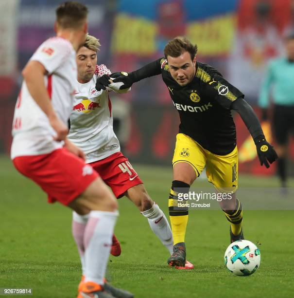 Mario Goetze of Dortmund fights for the ball with Kevin Kampl of Leipzig during the Bundesliga match between RB Leipzig and Borussia Dortmund at Red...