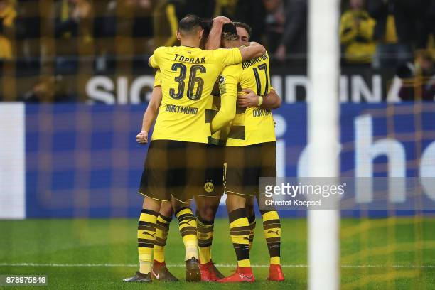 Mario Goetze of Dortmund is celebrated by his team mates after he scored a goal to make it 30 during the Bundesliga match between Borussia Dortmund...