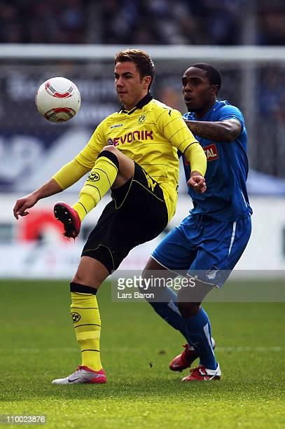 Mario Goetze of Dortmund is challenged by David Alaba of Hoffenheim during the Bundesliga match between 1899 Hoffenheim and Borussia Dortmund at...