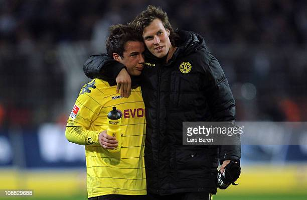 Mario Goetze of Dortmund is seen with team mate Kevin Grosskreutz after the Bundesliga match between Borussia Dortmund and FC Schalke 04 at Signal...