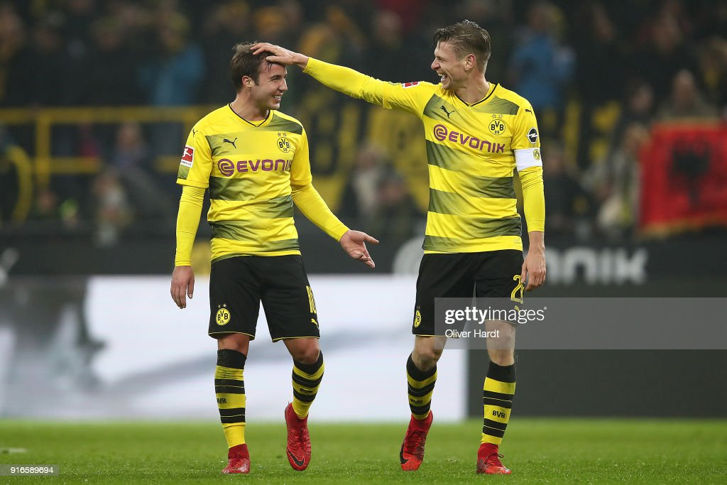 Mario Goetze of Dortmund (l) jokes with Lukasz Piszczek of Dortmund after the Bundesliga match between Borussia Dortmund and Hamburger SV at Signal Iduna Park on February 10, 2018 in Dortmund, Germany.