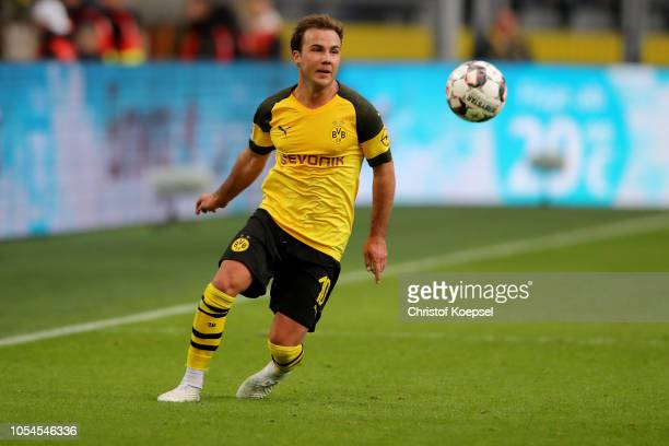 Mario Goetze of Dortmund runs with the ball during the Bundesliga match between Borussia Dortmund and Hertha BSC at Signal Iduna Park on October 27...
