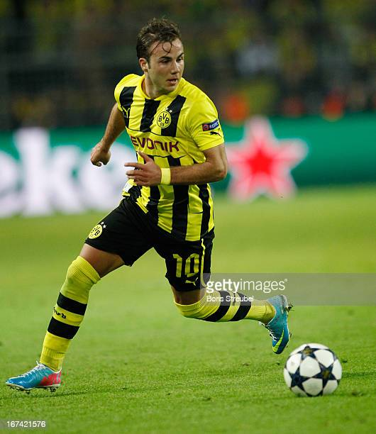 Mario Goetze of Dortmund runs with the ball during the UEFA Champions League semi final first leg match between Borussia Dortmund and Real Madrid at...