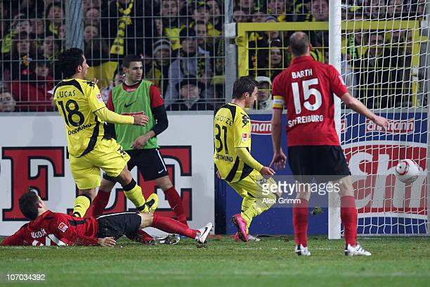 Mario Goetze of Dortmund scores his team's second goal during the Bundesliga match between SC Freiburg and Borussia Dortmund at the Badenova Stadium...