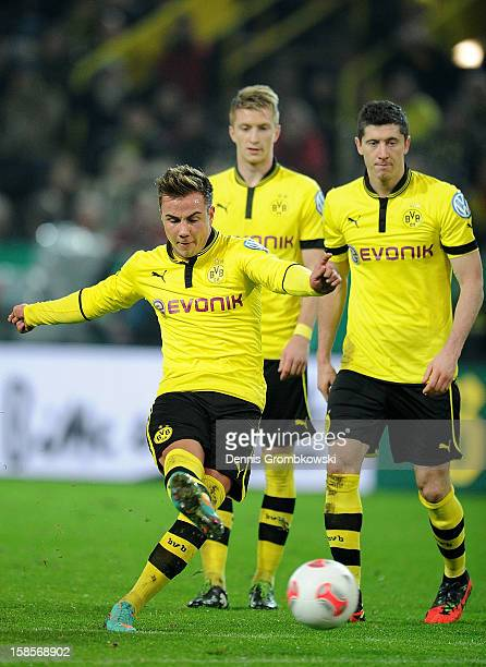 Mario Goetze of Dortmund scores his team's third goal during the DFB Cup match between Borussia Dortmund and Hannover 96 at Signal Iduna Park on...
