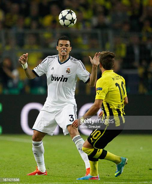 Mario Goetze of Dortmund watches Raphael Varane of Madrid controlling the ball during the UEFA Champions League semi final first leg match between...