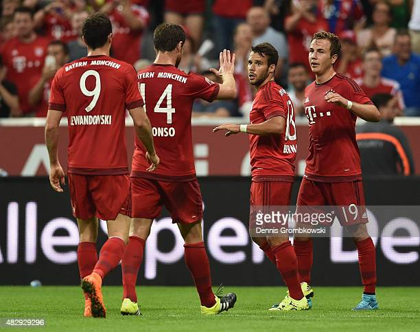 Mario Goetze of FC Bayern Muenchen celebrates as he scores the second goal during the Audi Cup 2015 match between FC Bayern Muenchen and AC Milan at...