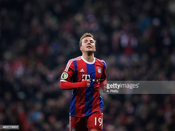 Mario Goetze of FC Bayern Muenchen celebrates scoring the second goal during the DFB Cup match between FC Bayern Muenchen and Eintracht Braunschweig...