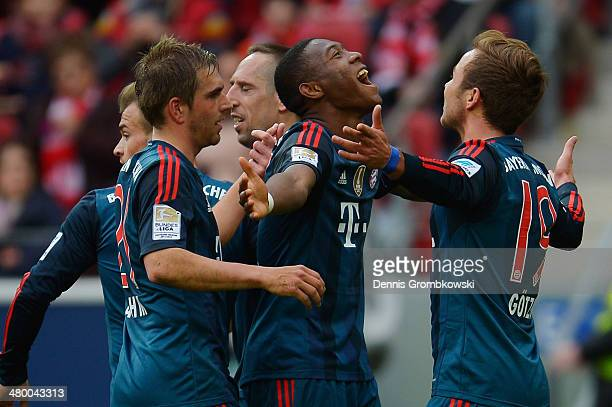 Mario Goetze of FC Bayern Muenchen celebrates with team mates after scoring his team's second goal during the Bundesliga match between 1 FSV Mainz 05...