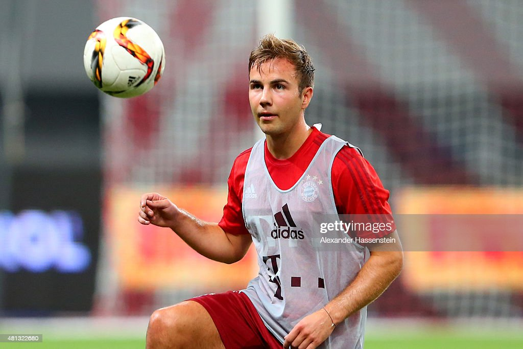 Mario Goetze of FC Bayern Muenchen plays with the ball during a training session at Shanghai Stadium on day 3 of the FC Bayern Audi China Summer Pre-Season Tour on July 19, 2015 in Shanghai, China.