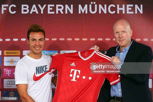 Mario Goetze of FC Bayern Muenchen presents his new match jersey with sporting director Matthias Sammer after a press conference at Bayern Muenchens...