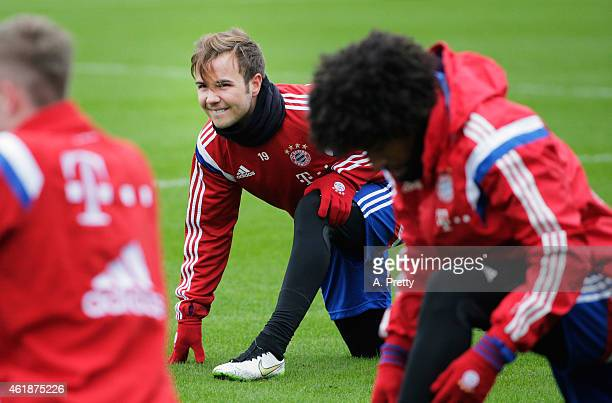 Mario Goetze of FC Bayern Muenchen stretches during training at Bayern Muenchen Training grounds on January 21 2015 in Munich Germany