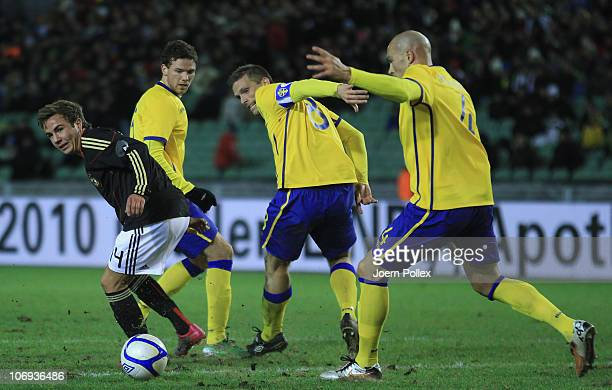 Mario Goetze of Germany and Anders Svensson of Sweden battle for the ball during the international friendly match between Sweden and Germany at...