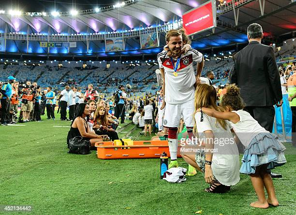 Mario Goetze of Germany and his girlfriend AnnKathrin Brommel play around with Soley Boateng and Lamia Boateng twin daughters of Jerome Boateng...