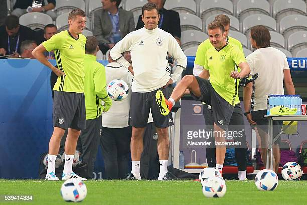 Mario Goetze of Germany and his team mate Toni Kroos plays with the ball during a Germany training session at Stade PierreMauray ahead of their...
