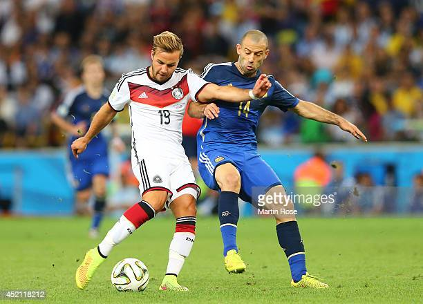 Mario Goetze of Germany and Javier Mascherano of Argentina compete for the ball during the 2014 FIFA World Cup Brazil Final match between Germany and...