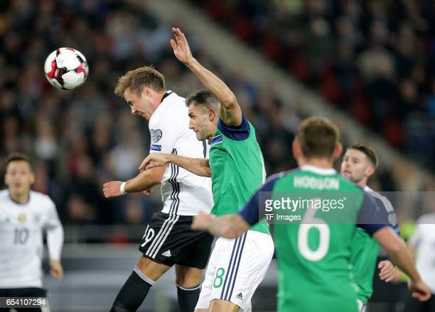 Mario Goetze of Germany and Steven Davis of Northern Ireland battle for the balll during the FIFA 2018 World Cup Qualifier between Germany and...