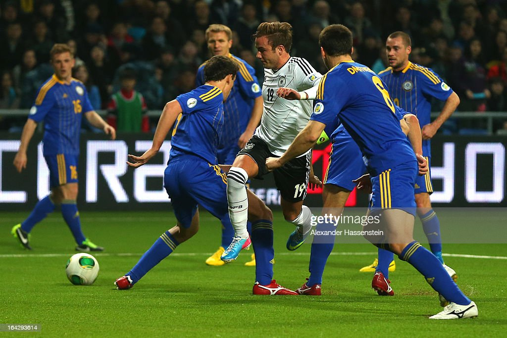 Mario Goetze (C) of Germany battles for the ball with Mark Gurman (C-L) of Kazakhstan during the FIFA 2014 World Cup qualifier group C match between Kazakhstan and Germany at Astana Arena on March 22, 2013 in Astana, Kazakhstan.