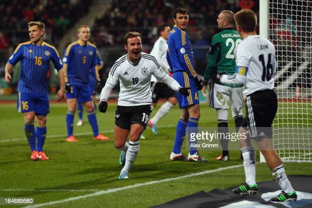 Mario Goetze of Germany celebrates his team's second goal with team mate Philipp Lahm during the FIFA 2014 World Cup qualifier between Germany and...