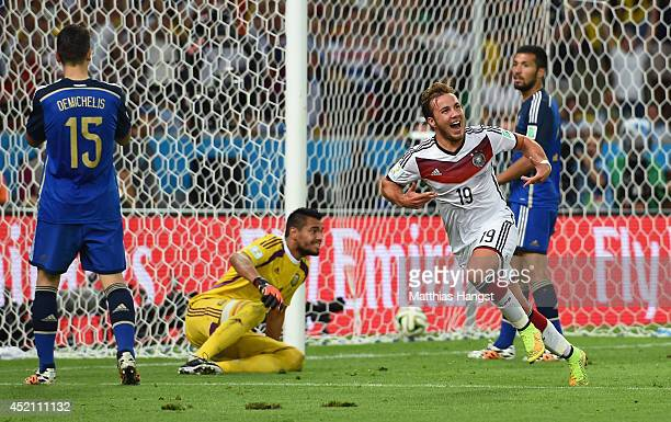 Mario Goetze of Germany celebrates scoring his team's first goal in extra time during the 2014 FIFA World Cup Brazil Final match between Germany and...