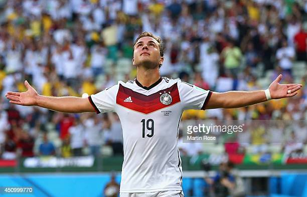 Mario Goetze of Germany celebrates scoring his team's first goal during the 2014 FIFA World Cup Brazil Group G match between Germany and Ghana at...
